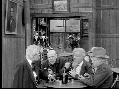 1913 reenactment b/w montage - wide shot group of old men talking and snorting snuff tobacco around table in bar / army officer looking through binoculars on battlefield near horse and two other soldiers / usa  - battlefield stock videos & royalty-free footage
