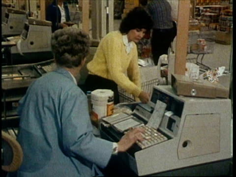 montage woman enters supermarket cu cashier looking through coupons checking out groceries people shopping zoom out from box of tide detergent - cash register stock videos and b-roll footage