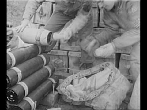 vídeos de stock, filmes e b-roll de montage world war ii us soldiers pack warning leaflets into shells these will be fired at cassino area to warn civilians of impending allied attack... - molho