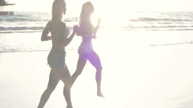 montage-running beach blond twin pier sunset california santa monica santamonicavideo - santa monica pier stock videos & royalty-free footage