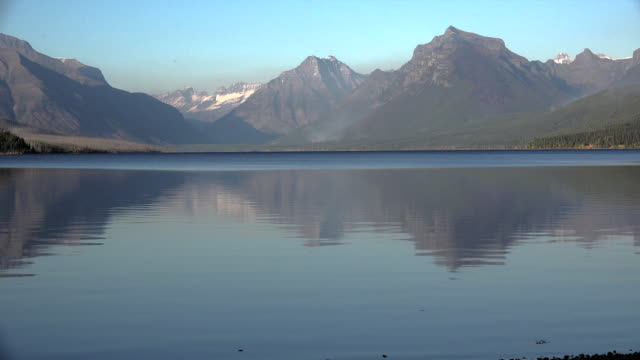 montana reflected mountains in lake macdonald - glacier national park us stock videos and b-roll footage