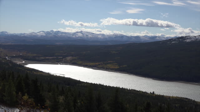 montana view of a lake in the sun.mov - glacier national park us stock videos and b-roll footage