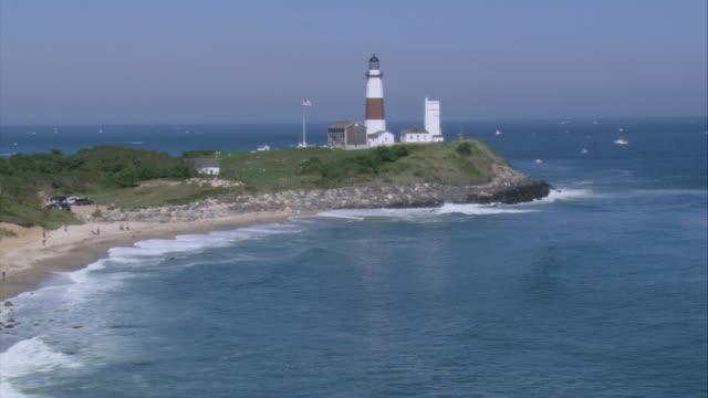 aerial montauk point lighthouse / montauk, new york, united states - ロングアイランド点の映像素材/bロール