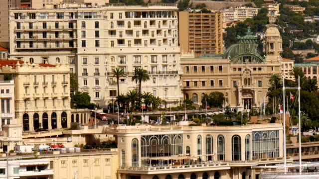 monte carlo casino next to fancy houses in monte carlo monaco at daytime. static medium wide shot. - exclusive stock videos & royalty-free footage