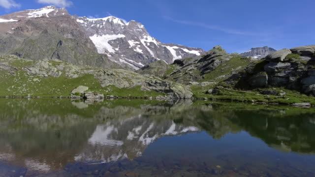 monte rosa and lago delle pisse, italy - piemonte video stock e b–roll