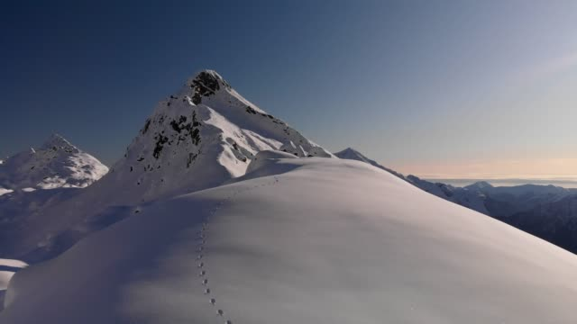 monte rosa mountain on winter, footsteps on snow and valley view - drone - mountain stock videos & royalty-free footage