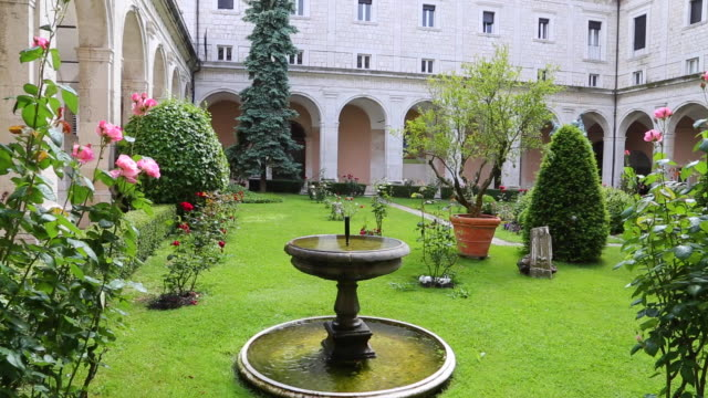 montecassino monastery, the gardens and the fountain in the church complex - monastero video stock e b–roll