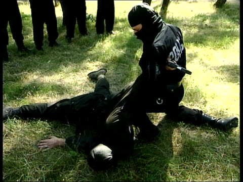 Independence Mooves ITN MONTENEGRO Podgoricia Montenegran special police practising fighting in field LA GV Special police along as training CMS Gun...