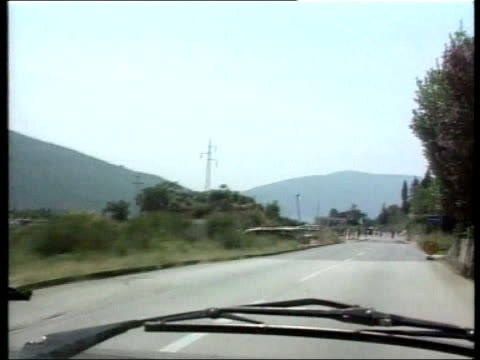 independence mooves; montenegran tv ext gvs federal soldiers loyal to milosevic at check point int car gvs serb tanks on roadside seen through car... - montenegro stock videos & royalty-free footage