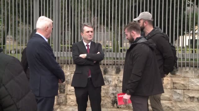 montenegro's interior minister visits the site of an attack on the country's us embassy after a serbian born suicide bomber threw a grenade into the... - compounding stock videos and b-roll footage