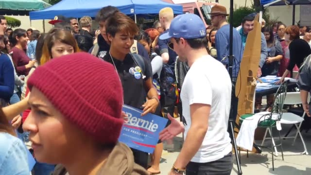 vídeos de stock, filmes e b-roll de monterey park ca students gather at free speech zone for voter registration in support of bernie sanders actress and activist frances fisher and... - dawson city