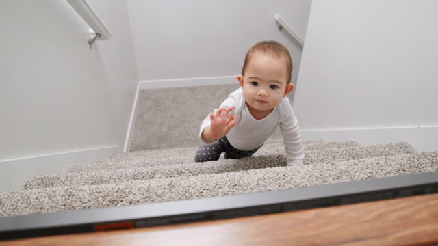 12 month old baby climbing stairs in a home - babies only stock videos & royalty-free footage