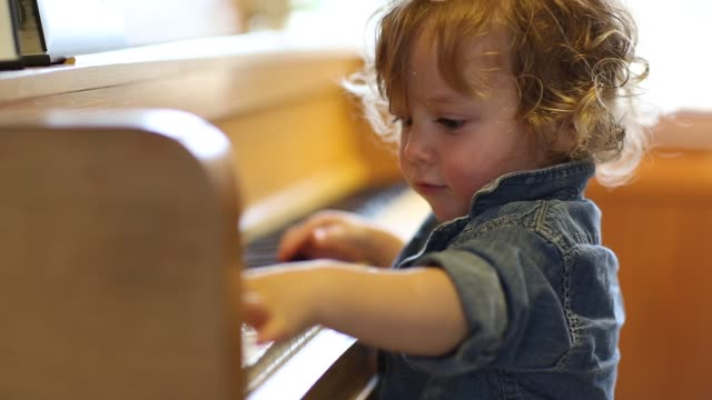 15 month old toddler boy playing piano. - piano stock videos & royalty-free footage