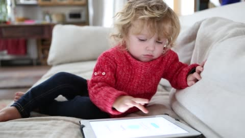 14 month old toddler boy playing with a digital tablet computer - babies only stock videos & royalty-free footage
