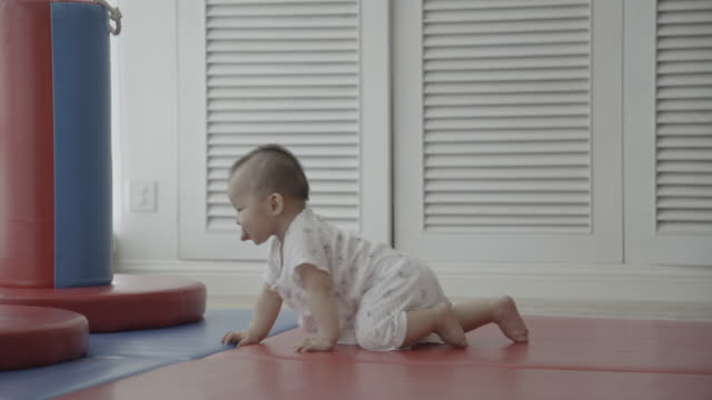 r/t ms 7 months asian baby girl crawling on mat with joy / chongqing, china - crawling stock videos & royalty-free footage