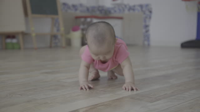 6 months baby girl learning to crawl on home floor - crawling stock videos & royalty-free footage