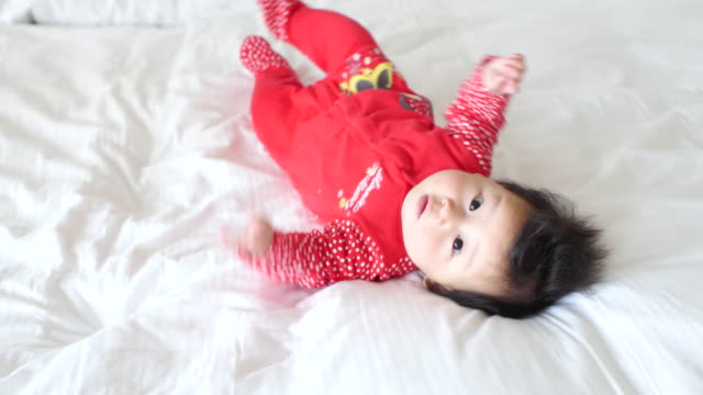 6 months baby girl try crawling - babies only stock videos & royalty-free footage
