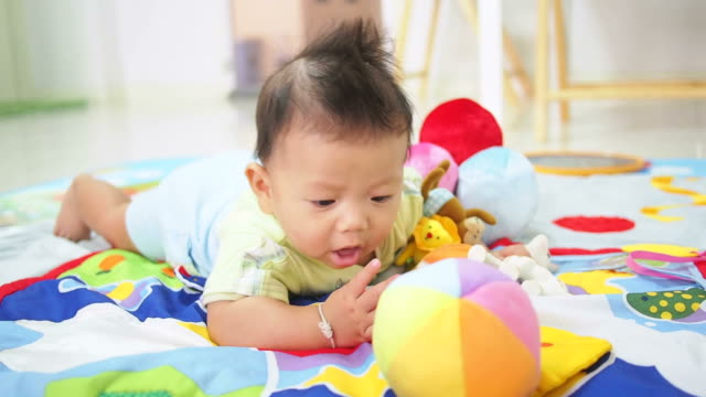 6 Months baby playing with toys