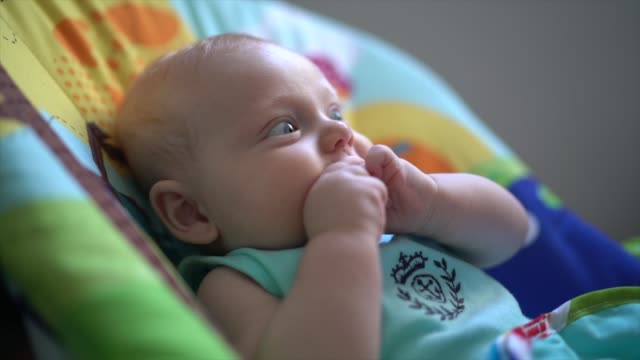 3 months baby putting his fingers in mouth - hungry stock videos and b-roll footage