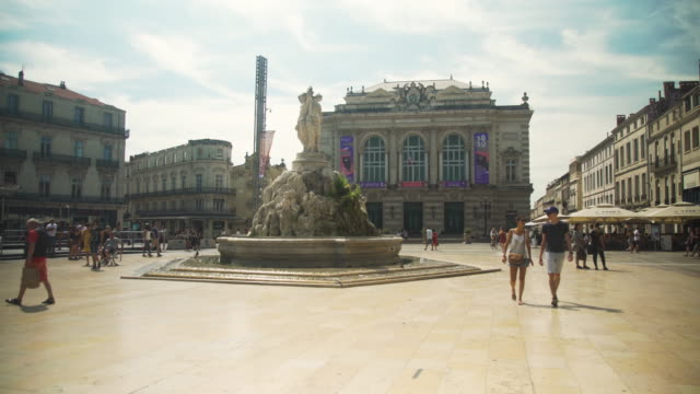 montpellier iconic image at comedie square with multi colored tramway - monument stock videos & royalty-free footage