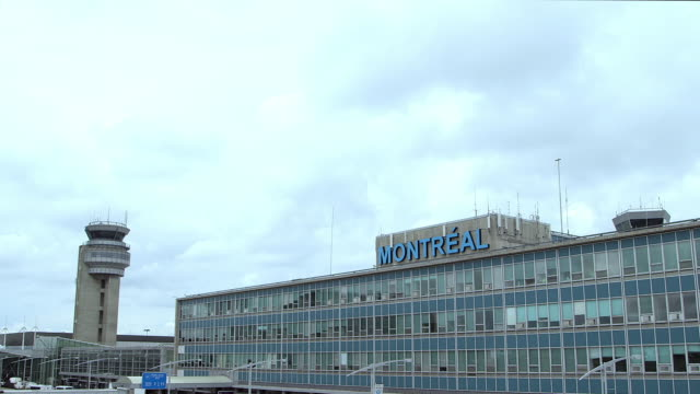 stockvideo's en b-roll-footage met montreal airport main building with control tower - montréal