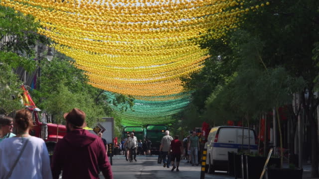 montreal, canada: gay village or simply the village rainbow coloured plastic balls decoration in the famous neighbourhood which is a tourist attraction - montreal video stock e b–roll