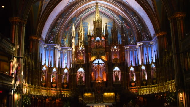 Montreal, Canada: Notre-Dame basilica church indoors. Beautiful multi colour altar. The famous place is a major tourist attraction in the Canadian city