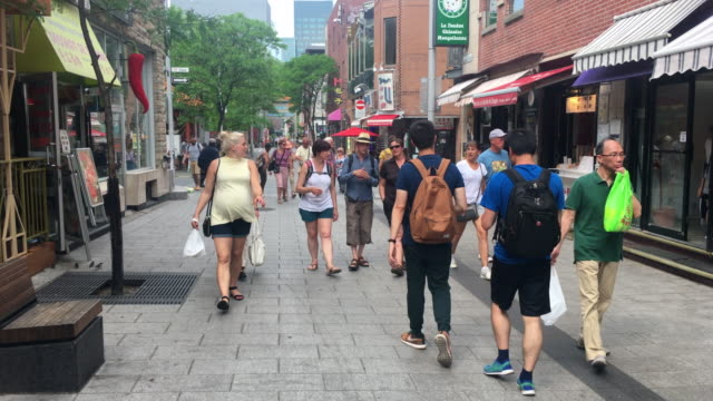 Montreal city's Chinatown everyday lifestyle. Point of view image of real people and traffic in the famous urban neighborhood, Canada