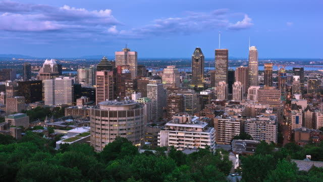 t/l montreal's skyline at twilight from the viewpoint at the observatory of the chalet du mont royal / montreal, quebec, canada - montreal video stock e b–roll