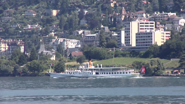 montreux and an old excursion boat on lake geneva - montreux stock videos & royalty-free footage