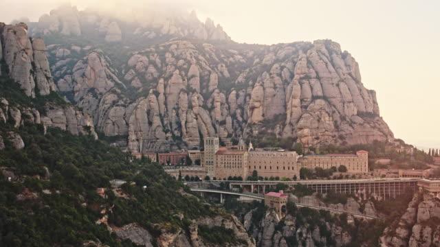 montserrat monastery barcelona catalonia spain 4k video - monastero video stock e b–roll
