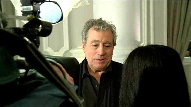 monty python reunion; terry jones interview sot - he's a very naughty boy jones as interviewed by itn crew michael palin sitting chatting with itn... - モンティ・パイソン点の映像素材/bロール