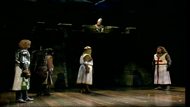 monty python's broadway musical hits west end; england: london: palace theatre ext palace theatre entrance with 'spamalot' musical sign tilt down to... - モンティ・パイソン点の映像素材/bロール