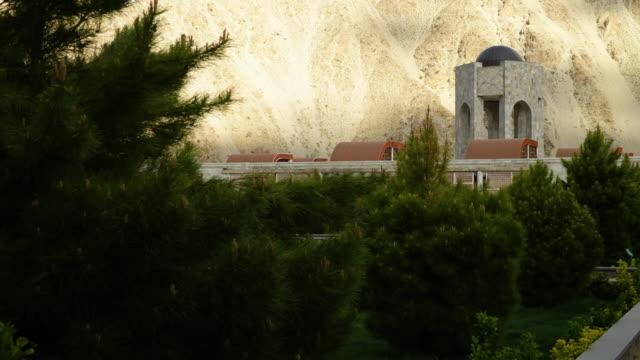 vídeos y material grabado en eventos de stock de a monument seen through the trees - pinar