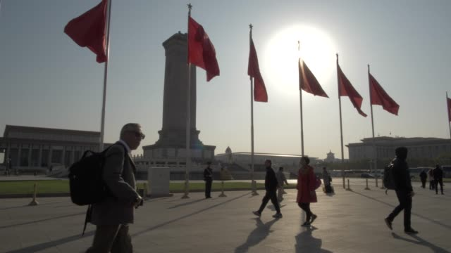 monument to the people's heroes and flags in tiananmen square, beijing, people's republic of china, asia - beijing stock videos & royalty-free footage