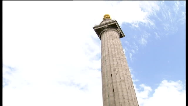 monument tower to be restored; slow motion shot of bus passing monument tower low angle view of monument int low angle shot looking up through spiral... - perching stock videos & royalty-free footage