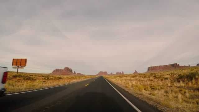 monument valley awesome rock formations - road trip in the united states - monument valley stock videos & royalty-free footage