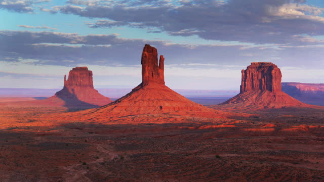 monument valley buttes at sunset - navajo reservation stock videos and b-roll footage