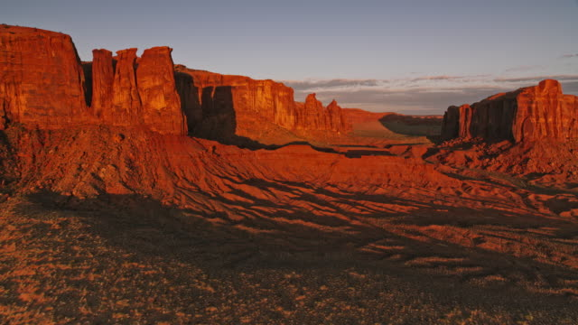 aerial monument valley national park in early morning sun - monument valley stock videos & royalty-free footage