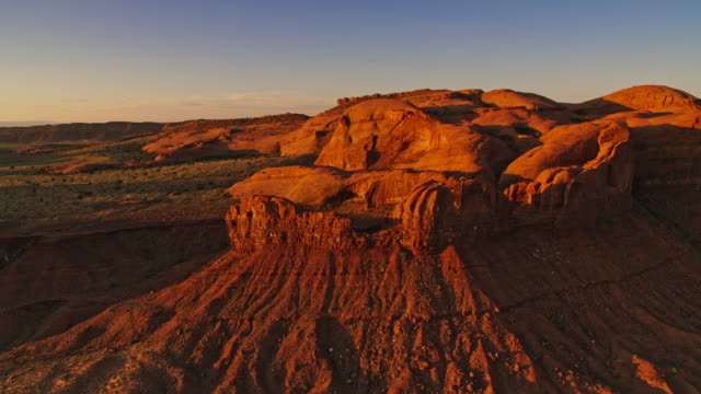aerial monument valley national park in the morning sun - monument valley stock videos & royalty-free footage