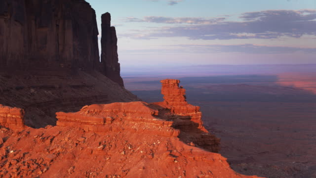 monument valley outcrops at sunset - navajo reservation stock videos and b-roll footage