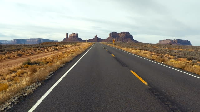 monument valley outstanding rock formations - road trip in the united states - monument valley stock videos & royalty-free footage