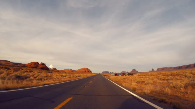 monument valley outstanding rock formations - road trip in the united states - arizona stock videos & royalty-free footage