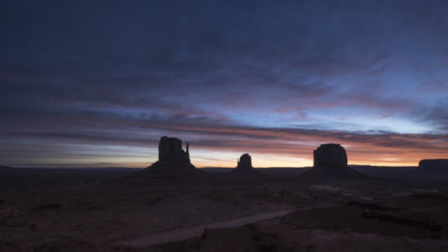 monument valley sunrise time lapse - navajo reservation stock videos and b-roll footage