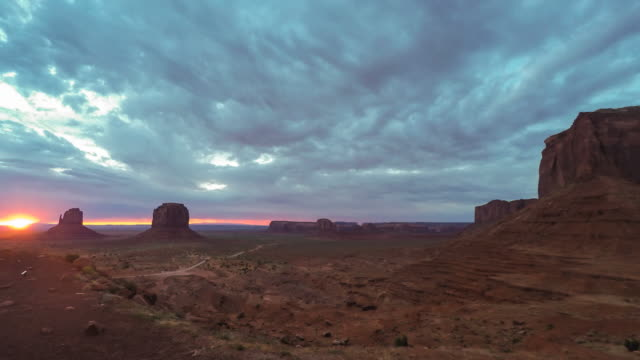 monument valley sunrise - canyon stock videos and b-roll footage
