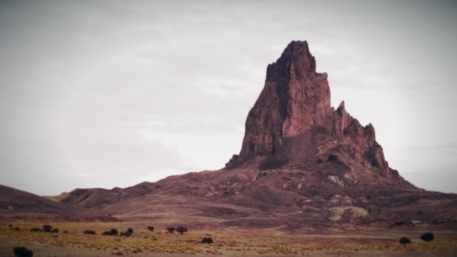 monument valley sunset with mountain - moab utah stock videos & royalty-free footage