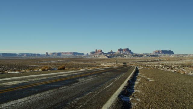 monument valley us route 163 snow colorado plateau - colorado plateau stock videos & royalty-free footage