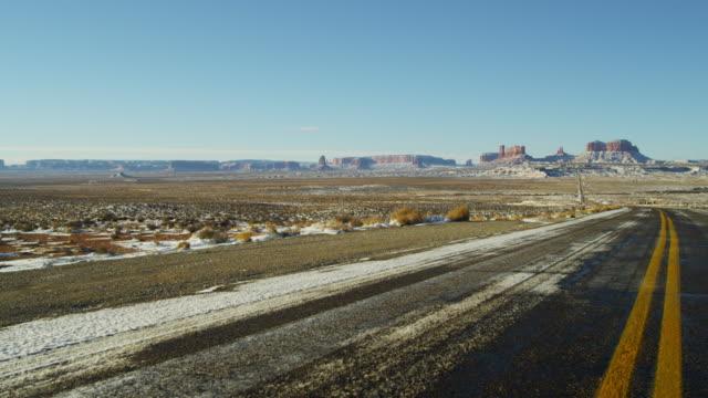 monument valley us route 163 utah colorado plateau - colorado plateau stock videos & royalty-free footage