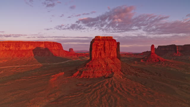 aerial monument valley, usa in the early morning sun - geology stock videos & royalty-free footage