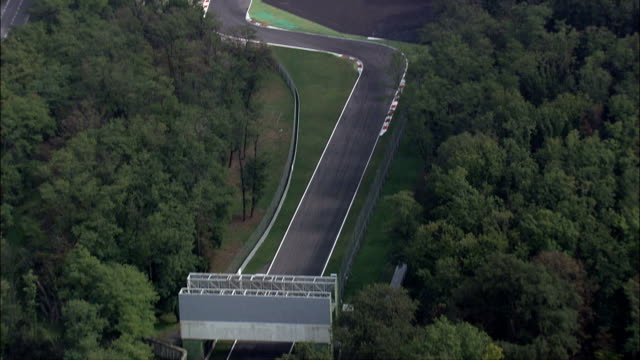 monza race track  - aerial view - lombardy, monza brianza, monza, italy - railway track stock videos & royalty-free footage
